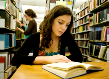 female_student_studying_in_library